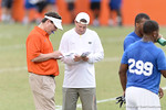 Florida Gator head coach Will Muschamp compares notes on the players. 2014 Friday Night Lights.  July 25th, 2014. Gator Country photo by David Bowie.