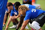 Offensive line recruit Matthew Burrell gets down in a 3 point stance. 2014 Friday Night Lights.  July 25th, 2014. Gator Country photo by David Bowie