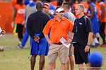Florida Gator head coach Will Muschamp and defensive coordinator D.J. Durkin talk at midfield during Friday Night Lights. 2014 Friday Night Lights.  July 25th, 2014. Gator Country photo by David Bowie.