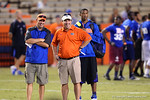 Florida Gator coaches Will Muschamp and Kurt Roper are all smiles as they watch the recruits compete during Friday Night Lights. 2014 Friday Night Lights.  July 25th, 2014. Gator Country photo by David Bowie.