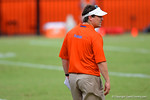 Florida Gator head coach Will Muschamp walks the field watching the recruits compete in the drills.2014 Friday Night Lights.  July 25th, 2014. Gator Country photo by David Bowie.