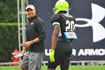 Team Nitro head coach Herm Edwards encourages Oregon commit safety Arrion Springs after he made a great play.  Under Armour All America Football Bowl Practice Day 1.  Orlando,FL.  December 29, 2013.  Gator Country photo by David Bowie.