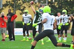 Michigan commit QB Wilton Speight throws downfield to 2014 Florida Gator commit WR Ermon Lane.  Under Armour All America Football Bowl Practice Day 1.  Orlando,FL.  December 29, 2013.  Gator Country photo by David Bowie.