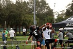 Florida Gators wide receiver commit Josh Hammond catches a pass over defensive back Kristian Fulton at Under Armour All-American Practice Day One. GatorCountry photo by Kassidy Hill