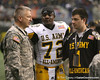 Haltom City, Texas (Haltom HS) defensive end Reggie Wilson talks with a soldier after the U.S. Army All-American Bowl on Saturday, January 9, 2010 at the Alamodome in San Antonio, Texas. / Gator Country photo by Tim Casey