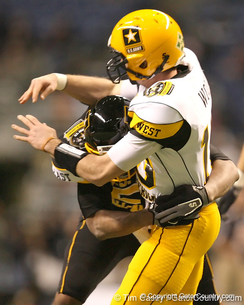 Hollandale, Miss. (Simmons School) defensive end Carlos Thompson hits Connor Wood during the first half of the U.S. Army All-American Bowl on Saturday, January 9, 2010 at the Alamodome in San Antonio, Texas. / Gator Country photo by Tim Casey