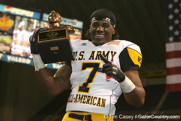 Moreno Valley, Calif. (Rancho Verde HS) defensive end Ronald Powell poses with the Pete Dawkins Trophy for being named Most Valuable Player of the U.S. Army All-American Bowl on Saturday, January 9, 2010 at the Alamodome in San Antonio. / Gator Country photo by Tim Casey