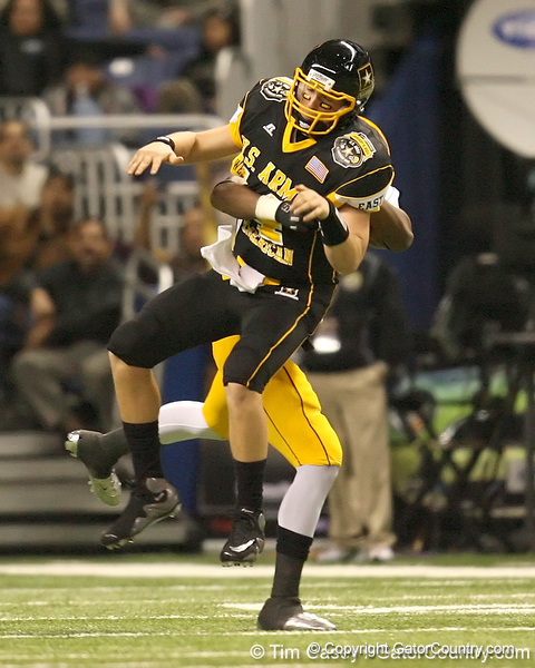 Bronx, N.Y. (The Fieldston School) quarterback Cole Marcoux gets hit during the second half of the U.S. Army All-American Bowl on Saturday, January 9, 2010 at the Alamodome in San Antonio, Texas. / Gator Country photo by Tim Casey