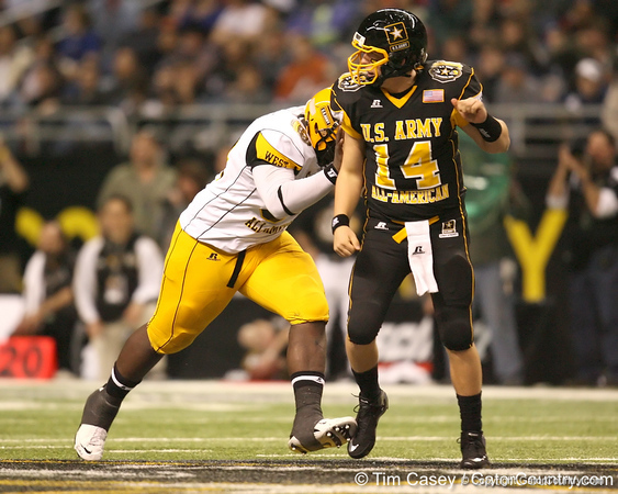 Tulsa, Okla. (Booker T. Washington HS) defensive tackle Calvin Barnett hits the quarterback during the second half of the U.S. Army All-American Bowl on Saturday, January 9, 2010 at the Alamodome in San Antonio, Texas. / Gator Country photo by Tim Casey