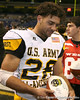 San Diego (Mission Bay HS) wide receiver Dillon Baxter signs an autograph after the U.S. Army All-American Bowl on Saturday, January 9, 2010 at the Alamodome in San Antonio, Texas. / Gator Country photo by Tim Casey