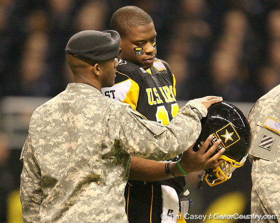 McKees Rocks, Penn. (Sto Rox HS) quarterback Paul Jones talks with a soldier the U.S. Army All-American Bowl on Saturday, January 9, 2010 at the Alamodome in San Antonio, Texas. / Gator Country photo by Tim Casey