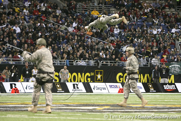 Soldiers deliver the game ball before the U.S. Army All-American Bowl on Saturday, January 9, 2010 at the Alamodome in San Antonio, Texas. / Gator Country photo by Tim Casey