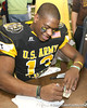 McKees Rocks, Penn. (Sto Rox HS) quarterback Paul Jones signs an autopgraph after the U.S. Army All-American Bowl on Saturday, January 9, 2010 at the Alamodome in San Antonio, Texas. / Gator Country photo by Tim Casey