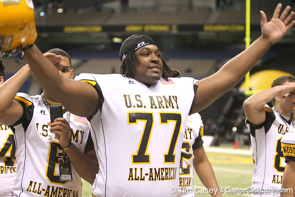 St. Paul, Minn. (Cretin-Derhim HS) offensive lineman Seantrel Henderson waves to soldiers during the first half of the U.S. Army All-American Bowl on Saturday, January 9, 2010 at the Alamodome in San Antonio, Texas. / Gator Country photo by Tim Casey
