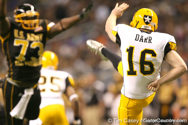 Bakersfield, Calif. (Temple HS) punter Matt Darr gets a punt off before Sharrif Floyd can make a block during the first half of the U.S. Army All-American Bowl on Saturday, January 9, 2010 at the Alamodome in San Antonio, Texas. / Gator Country photo by Tim Casey
