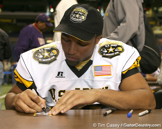 Plano, Texas (Plano West HS) defensive end Jackson Jeffcoat signs an autograph after the U.S. Army All-American Bowl on Saturday, January 9, 2010 at the Alamodome in San Antonio, Texas. / Gator Country photo by Tim Casey