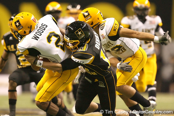 Iowa City, Iowa (City HS) defensive back A.J. Derby tackles punt returner Connor Wood on during the first half of the U.S. Army All-American Bowl on Saturday, January 9, 2010 at the Alamodome in San Antonio, Texas. / Gator Country photo by Tim Casey