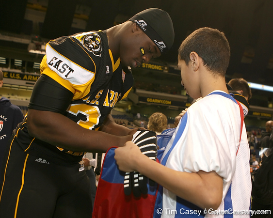 West Palm Beach, Fla. (Dwyer HS) linebacker Gerald Christian signs an autograph after the U.S. Army All-American Bowl on Saturday, January 9, 2010 at the Alamodome in San Antonio, Texas. / Gator Country photo by Tim Casey
