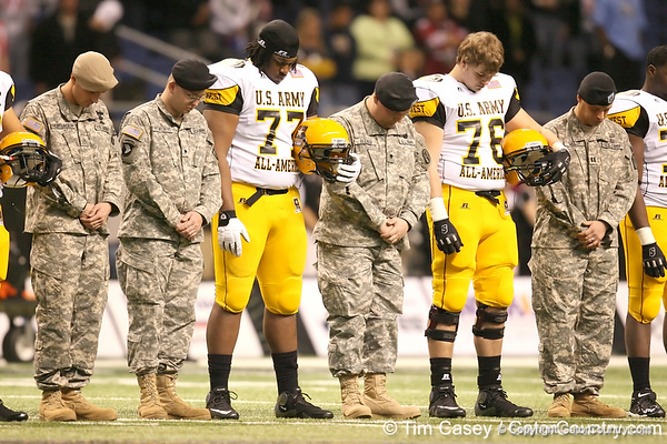 St. Paul, Minn. (Cretin-Derhim HS) offensive lineman Seantrel Henderson bows his head during a pregame prayer before the U.S. Army All-American Bowl on Saturday, January 9, 2010 at the Alamodome in San Antonio, Texas. / Gator Country photo by Tim Casey