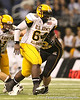 Tulsa, Okla. (Booker T. Washington HS) defensive tackle Calvin Barnett rushes the quarterback during the second half of the U.S. Army All-American Bowl on Saturday, January 9, 2010 at the Alamodome in San Antonio, Texas. / Gator Country photo by Tim Casey