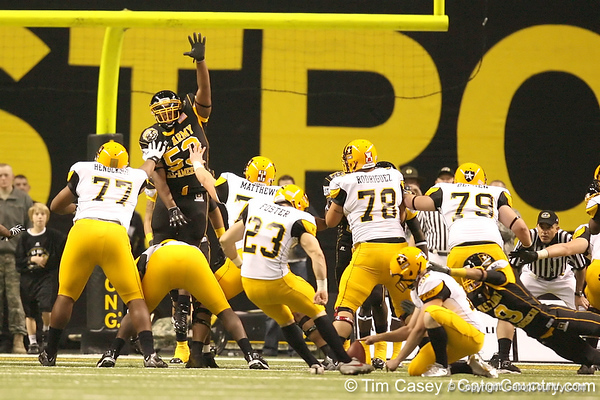 Chatham, Va. (Hargrave Military Academy) defensive end Ego Ferguson leaps to block an extra point during the first half of the U.S. Army All-American Bowl on Saturday, January 9, 2010 at the Alamodome in San Antonio, Texas. / Gator Country photo by Tim Casey