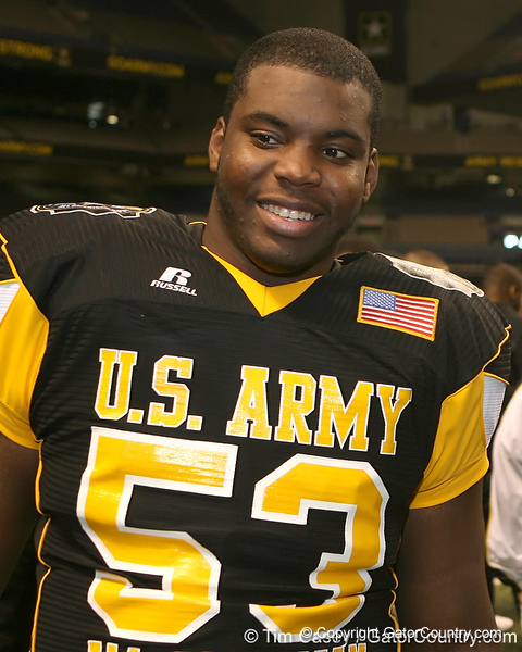 Chatham, Va. (Hargrave Military Academy) defensive end Ego Ferguson talks to relatives after the U.S. Army All-American Bowl on Saturday, January 9, 2010 at the Alamodome in San Antonio, Texas. / Gator Country photo by Tim Casey