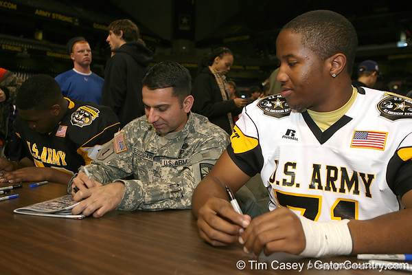 Allen, Texas (Allen HS) offensive lineman Cedric Ogbuehi signs autographs after the U.S. Army All-American Bowl on Saturday, January 9, 2010 at the Alamodome in San Antonio, Texas. / Gator Country photo by Tim Casey