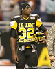 West Palm Beach, Fla. (Dwyer HS) linebacker Gerald Christian watches pre-game activities before the U.S. Army All-American Bowl on Saturday, January 9, 2010 at the Alamodome in San Antonio, Texas. / Gator Country photo by Tim Casey