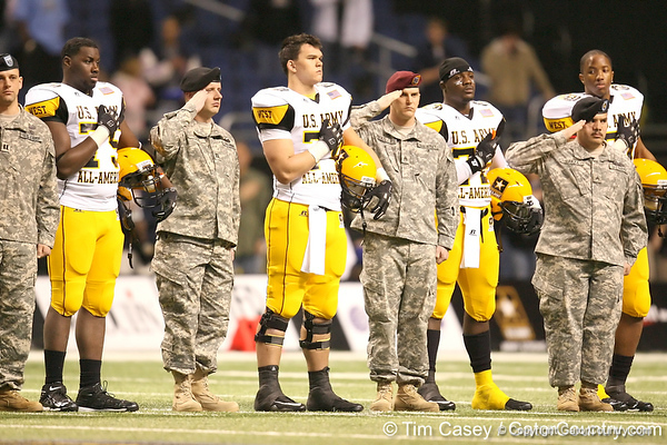 Galena Park, Texas (North Shore HS) offensive lineman Trey Hopkins and Missouri City, Texas (Elkins HS) offensive lineman listen to the national anthem before the U.S. Army All-American Bowl on Saturday, January 9, 2010 at the Alamodome in San Antonio, Texas. / Gator Country photo by Tim Casey
