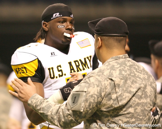 Moreno Valley, Calif. (Rancho Verde HS) defensive end Ronald Powell talks with a soldier before the U.S. Army All-American Bowl on Saturday, January 9, 2010 at the Alamodome in San Antonio, Texas. / Gator Country photo by Tim Casey