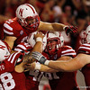 Sep 10, 2011; Lincoln, NE, USA;  Nebraska Cornhuskers Rex Burkhead (22) celebrates his touchdown with Mike Caputo (58) , Jake Long (41) , Ben Cotton (81) and Tyler Moore (73) against the Fresno State Bulldogs during the second half at Memorial Stadium. Nebraska won 42-29. Bruce Thorson-US PRESSWIRE