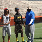 Defensive line coach Chris Rumph and WR Lavarus Tigner chat before the Florida Gators football camp on June 6th, 2015. Gator Country photo by Kassidy Hill.