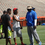 Defensive line coach Chris Rumph and CB Aaron Robinson chat before the Florida Gators football camp on June 6th, 2015. Gator Country photo by Kassidy Hill.