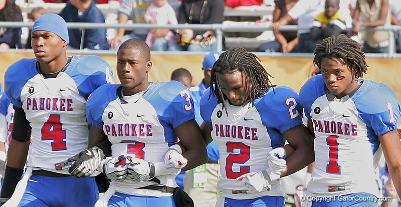From left to right, LB Brandin Hawthorne, DB Carlos Lammons, RB Vincent Smith, and WR Nu'Keese Richardson stride arm-and-arm to the pre-game coin toss as the captains for Pahokee before the FHSAA Class 2B final against Trinity Catholic on December 13, 2008.
