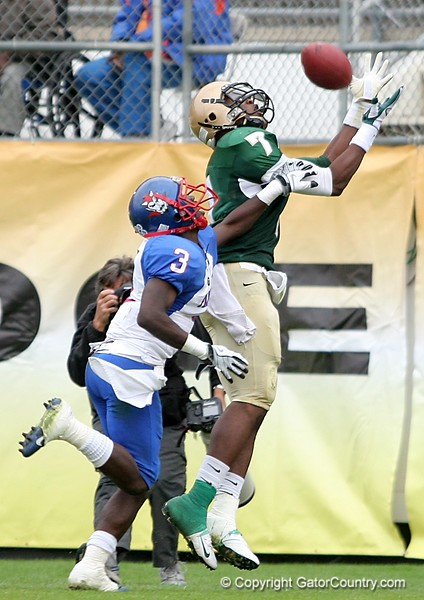 WR Kadron Boone of Trinity Catholic attempts to make the catch, while DB Carlos Lammons of Pahokee provides the coverage during the FHSAA Class 2B final on December 13, 2008.