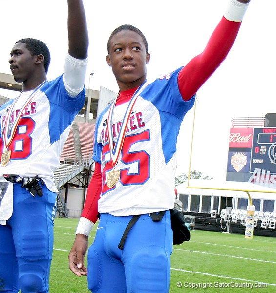 Zachary Allen (18) and Demetrius Dotting (25) celebrates after receiving their medals following Pahokee's 21-17 victory over Trinity Catholic in the FHSAA Class 2B final on December 13, 2008.