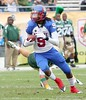 WR Dexter Rhodes of Pahokee breaks a tackle during second quarter action of the FHSAA Class 2B final on December 13, 2008.
