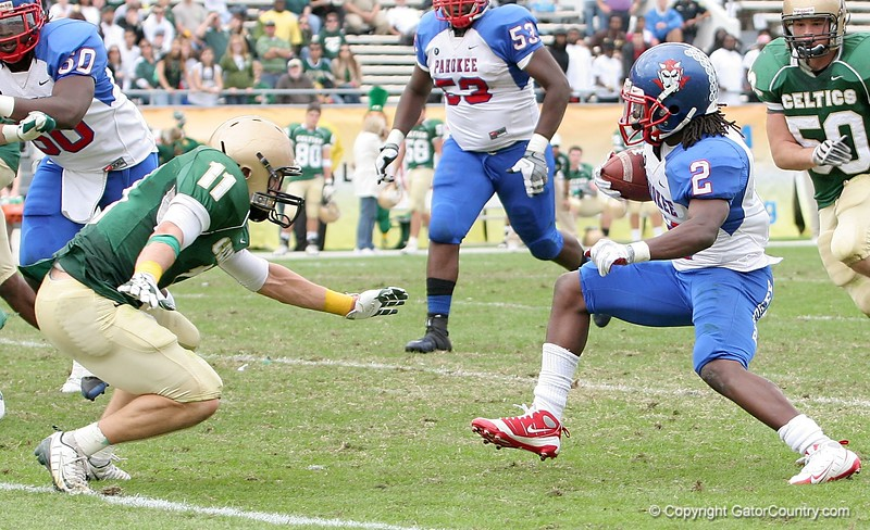 RB Vincent Smith of Pahokee carries the ball, while DB Johnny Lawroski of Trinity Catholic prepares to make the tackle during second quarter action of the FHSAA Class 2B final on December 13, 2008.