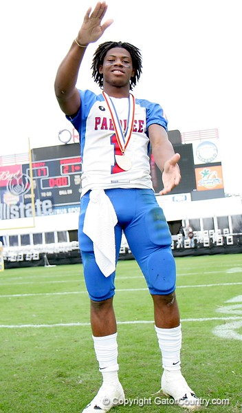 "Nu'Keese Richardson does the ""Gator chomp"" after receiving his medal following Pahokee's 21-17 victory over Trinity Catholic in the FHSAA Class 2B final on December 13, 2008."