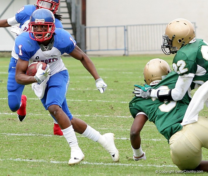WR Nu'Keese Richardson runs with the ball during the FHSAA Class 2B final against Trinity Catholic on December 13, 2008