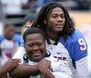 Dexter Holmes of Pahokee hugs a fan after the Blue Devis took the FHSAA Class 2B final 21-17 over Trinity Catholic on December 13, 2008.