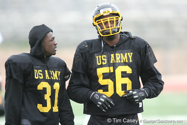 Darlington, S.C. (Darlington HS) defensive back Victor Hampton talks with Garrison Smith during the East team's fourth day of practice for the U.S. Army All-American Bowl on Thursday, January 7, 2010 at Gustafson Stadium at the Hardin Athletic Complex in San Antonio. / Gator Country photo by Tim Casey