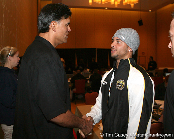 NFL Hall of Famer Anthony Mu–oz speaks with Dillon Baxter after the fourth day of practice for the U.S. Army All-American Bowl on Thursday, January 7, 2010 at the Grand Hyatt Hotel in San Antonio. / Gator Country photo by Tim Casey