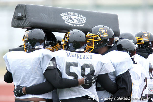 Offensive lineman huddle together to stay warm during the East team's fourth day of practice for the U.S. Army All-American Bowl on Thursday, January 7, 2010 at Gustafson Stadium at the Hardin Athletic Complex in San Antonio, Texas. / Gator Country photo by Tim Casey