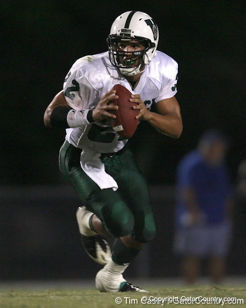 Venice High School senior Trey Burton (22) looks to pass during the Indians' 34-10 win against the Southeast Seminoles on Friday, October 2, 2009 at John Kiker Memorial Stadium in Bradenton, Fla. / Gator Country photo by Tim Casey