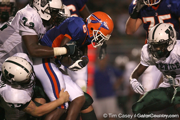 Southeast High School senior LaTrayon Fagins gets tackled during the Venice Indians' 34-10 win against the Seminoles on Friday, October 2, 2009 at John Kiker Memorial Stadium in Bradenton, Fla. / Gator Country photo by Tim Casey