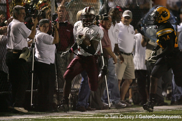 photo by Tim Casey<br /> <br /> Greg Reid gets run out of bounds during the Lowndes County High School Vikings' 14-7 win against the Valdosta Wildcats in the Winnersville Classic on Friday, October 10, 2008 at Cleveland Field at Bazemore-Hyder Stadium in Valdosta, Ga. <br /> <br /> Valdosta High defensive back Johnathan Mitchell was injured in a sideline collision with a band prop on the play. The junior cornerback  collided with a cameraman along the sideline, then crashed into a fence.<br /> <br /> Mitchell lay almost motionless for 25 minutes, as team trainers, then emergency medical staff, attended to him, and workers tried to remove his facemask, which had gotten stuck in the fence. Eventually, he was placed on a stretcher, then taken away in an ambulance to South Georgia Medical Center.<br /> <br /> Mitchell spent Friday and Saturday night in the hospital with a bruised spinal cord. He had movement in both of his legs and his arms, but was still kept at SGMC as a precaution.