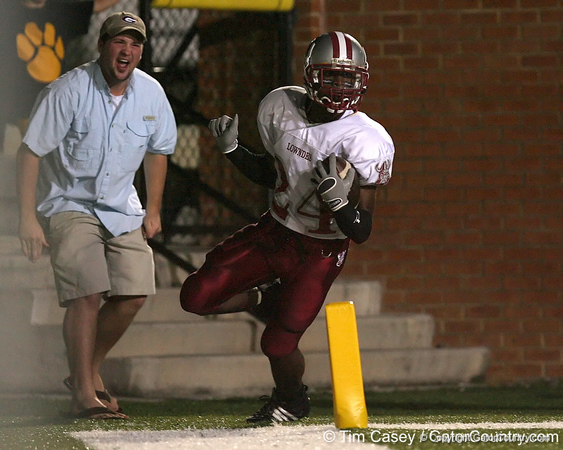 photo by Tim Casey<br /> <br /> Greg Reid scores on a 70-yard touchdown reception on the first play from scrimmage during the Lowndes County High School Vikings' 14-7 win against the Valdosta Wildcats in the Winnersville Classic on Friday, October 10, 2008 at Cleveland Field at Bazemore-Heyder Stadium in Valdosta, Ga.