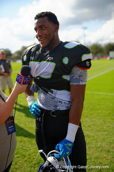 2015 high school football recruit defensive end Byron Cowart talks with Gator Country and other media outlets during the first day of practice for the 2015 Under Armour All-America High School Football Game.  2015 Under Armour All-America High School Football Game Practice Day 1.  December 29th, 2014. Gator Country photo by David Bowie.