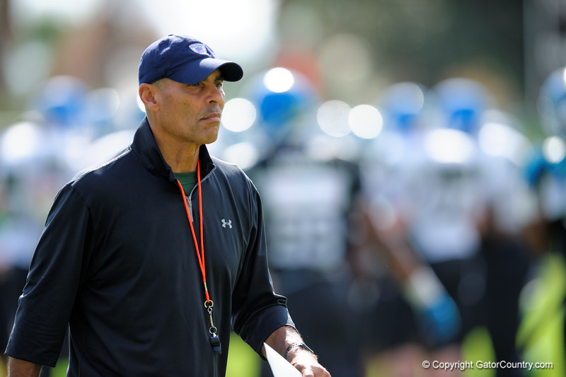 Coach Herm Edwards runs drills during the first day of practice for the 2015 Under Armour All-America High School Football Game.  2015 Under Armour All-America High School Football Game Practice Day 1.  December 29th, 2014. Gator Country photo by David Bowie.
